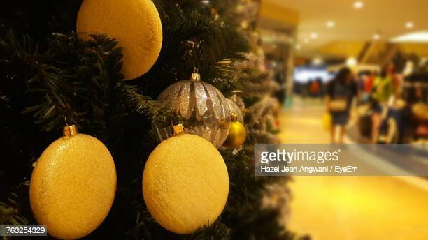 Close-Up Of Decorated Christmas Tree In Shopping Mall