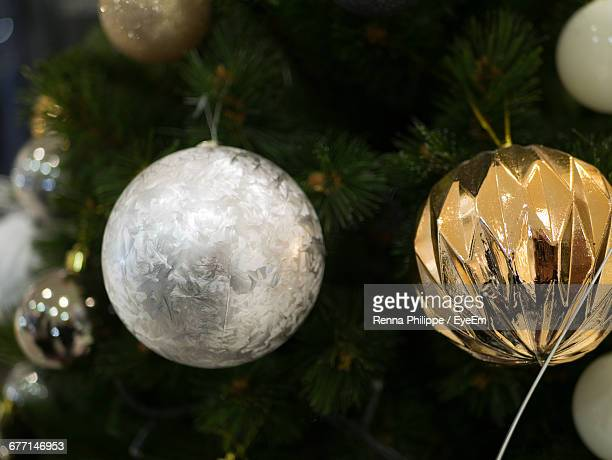 Close-Up Of Decorations Hanging On Christmas Tree