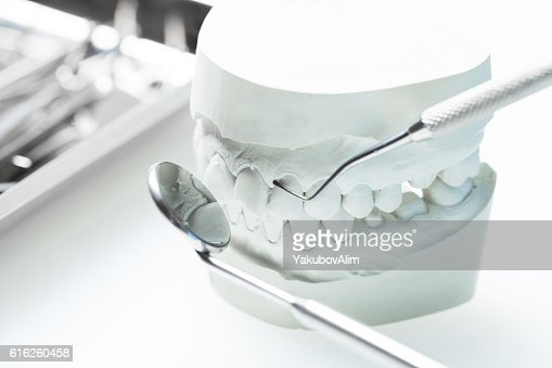 Close-up of dentist's hands and dental equipment : Stock Photo
