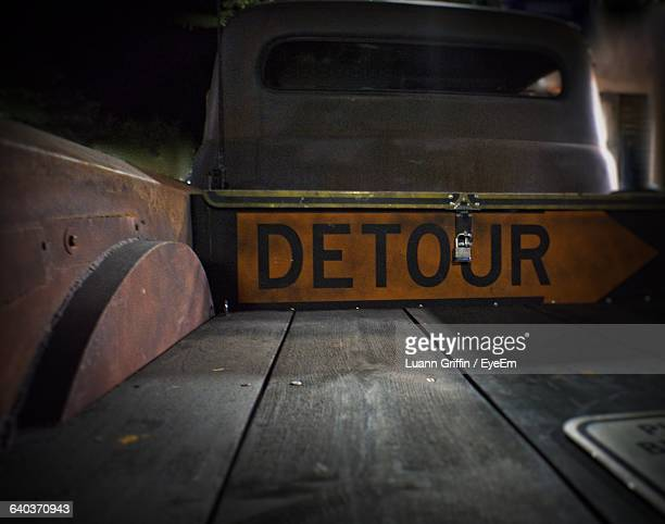 Close-Up Of Detour Sign On Truck