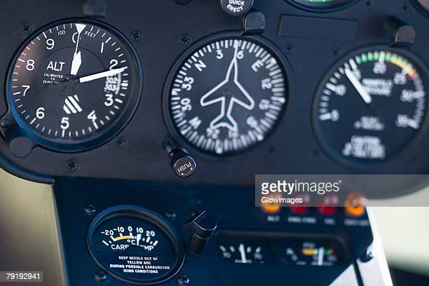 Close-up of dial gauges of an airplane