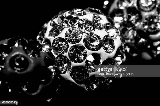Close-Up Of Diamond Jewelry Against Black Background