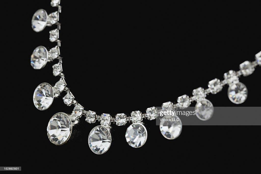 Close-up of diamond necklace on black background