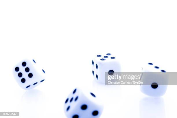 Close-Up Of Dices Over White Background