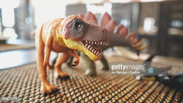 Close-Up Of Dinosaur Figurines On Table