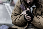 Close-up of dirty hands of beggar. Problems of homeless person in the city concept