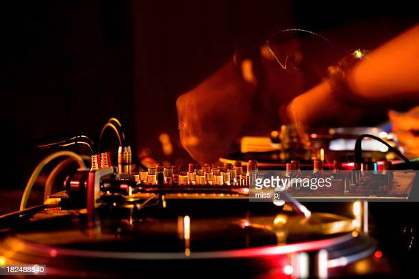 Close-up of DJ hands and sound equipment