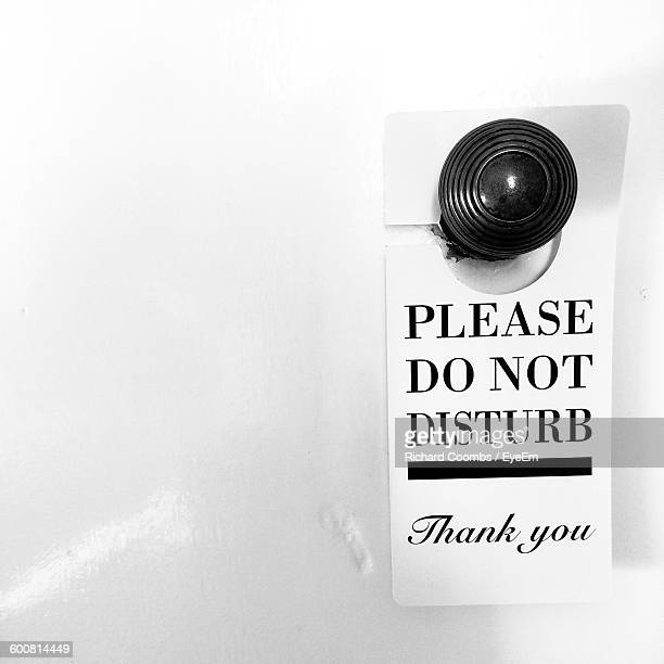 Close-Up Of Do Not Disturb Sign On Doorknob
