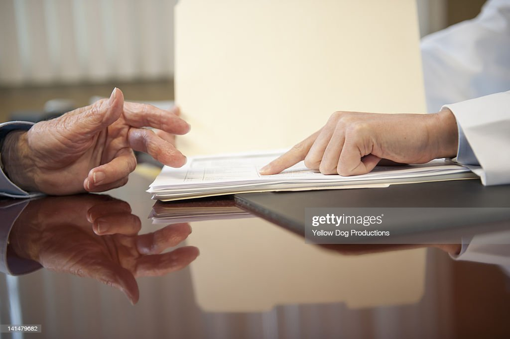 Close-up of Doctor and Elderly Patient's hands : Stock Photo