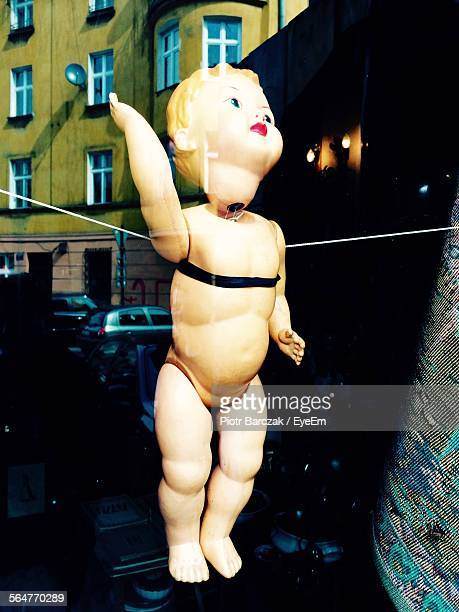 Close-Up Of Doll Hanging From String