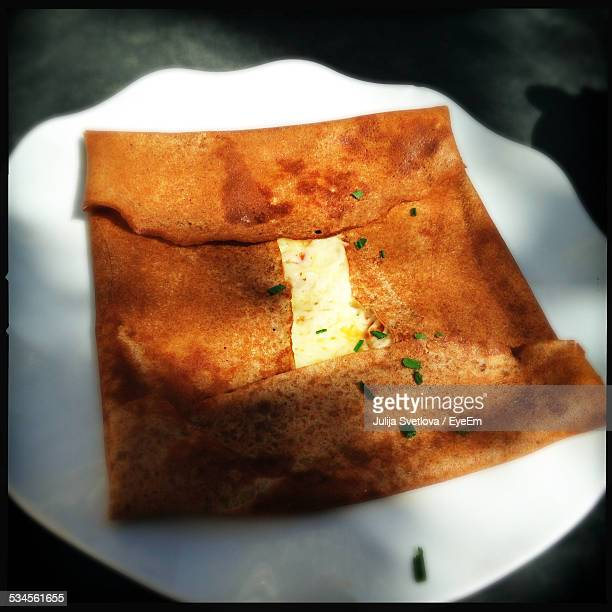 Close-Up Of Dosa Served In Plate