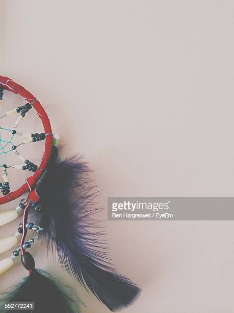 Close-Up Of Dreamcatcher Hanging On Wall