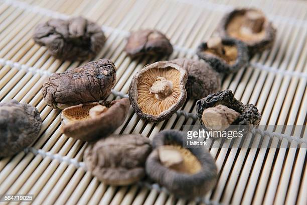 Close-up of dried mushrooms on bamboo mat