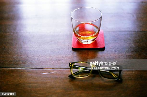 Close-Up Of Drink And Glasses On Table