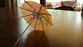 Close-Up Of Drink Umbrella On Restaurant Table