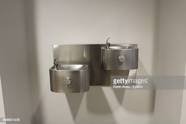 Close-Up Of Drinking Fountains On Wall