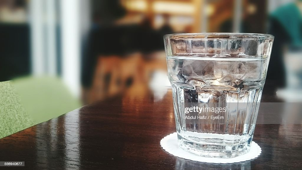 Close-Up Of Drinking Glass On Table : ストックフォト