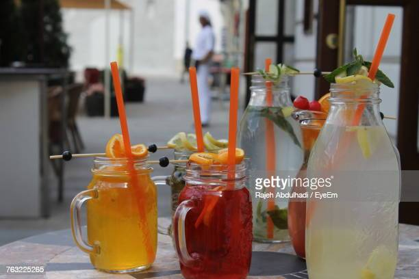 Close-Up Of Drinks In Mason Jar On Table