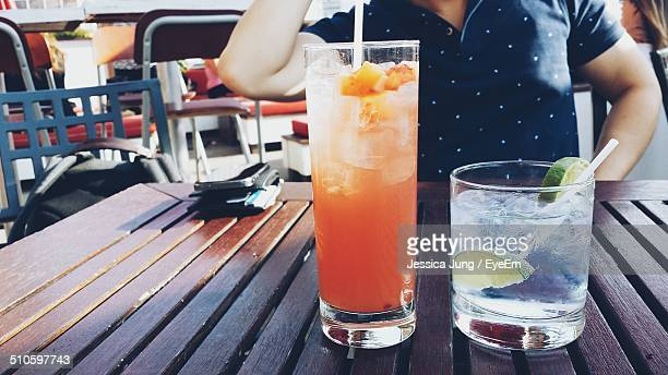 Close-up of drinks on wooden table