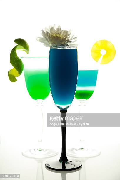 Close-Up Of Drinks Over White Background