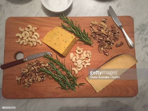 Close-Up Of Dry Fruits On Cutting Board