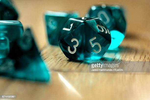 Close-Up Of Dungeons And Dragons Game Dices On Table