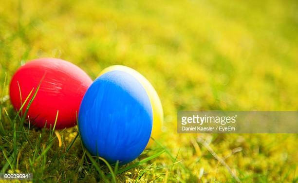 Close-Up Of Easter Eggs On Grassy Field