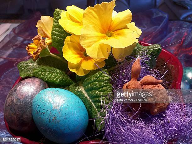 Close-Up Of Easter Eggs With Easter Bunny And Flowers