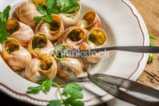 gros plan de manger des escargots au beurre lail frit photo thinkstock. Black Bedroom Furniture Sets. Home Design Ideas