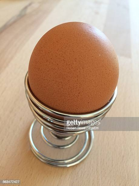 Close-Up Of Egg In Cup On Table