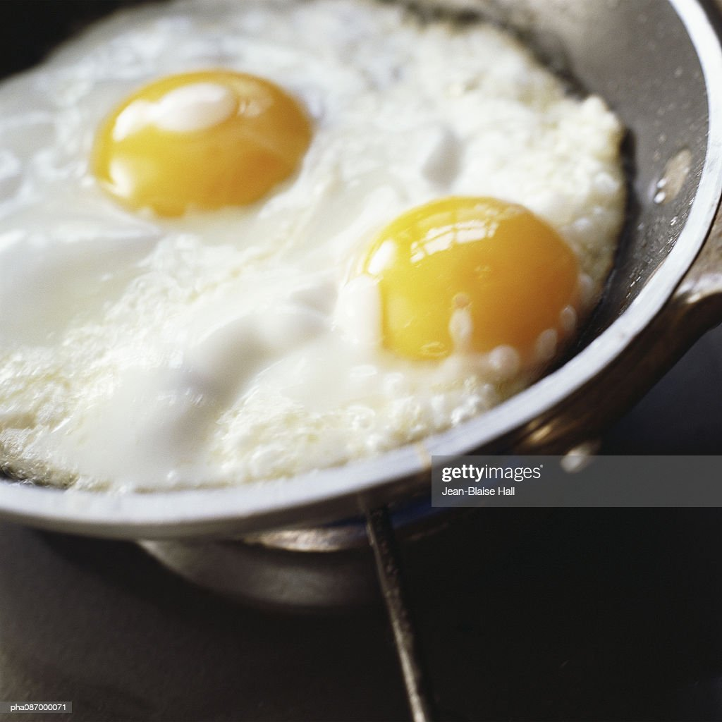 Close-up of eggs being cooked in a pan.