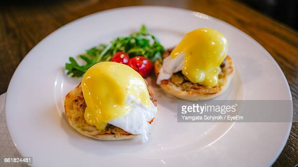 Close-Up Of Eggs Benedict In Plate On Table