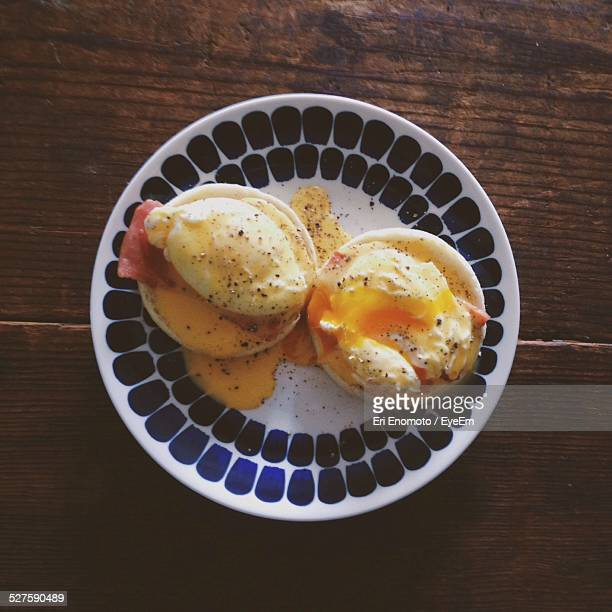 Close-Up Of Eggs Benedict Served In Plate