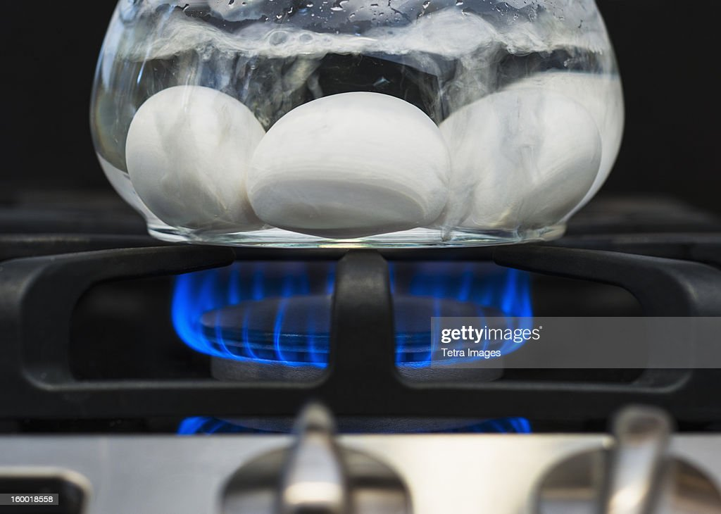 Close-up of eggs boiling on gas burner