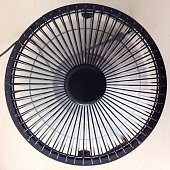 Close-Up Of Electric Fan Against White Background