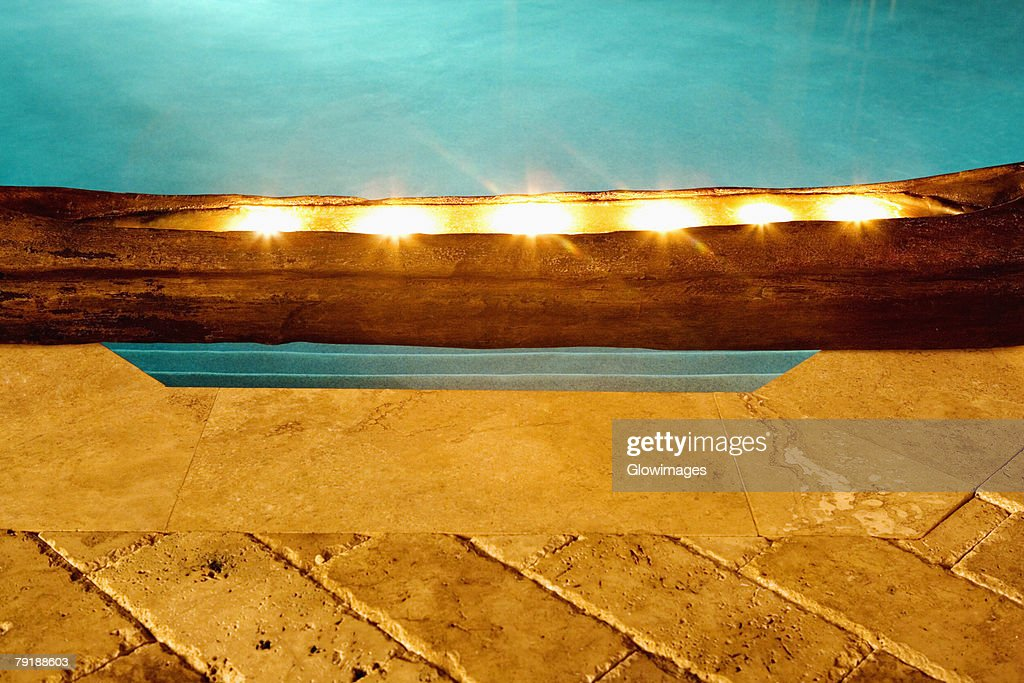 Close-up of electric lights at the poolside : Stock Photo