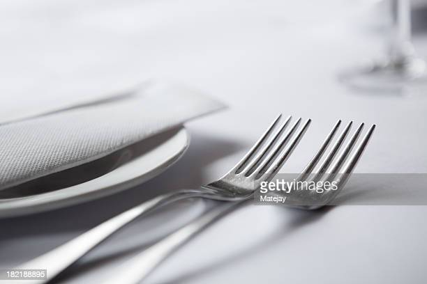 A close-up of elegant table setting with two forks