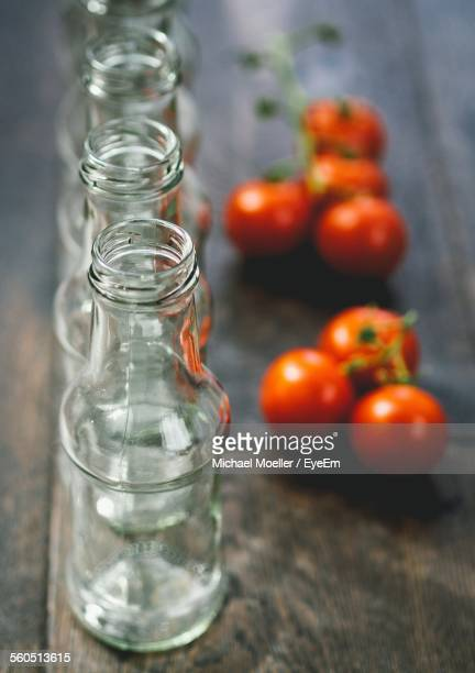 Close-Up Of Empty Bottles With Tomatoes