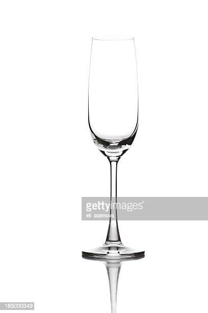 Closeup of empty champagne glass on white background