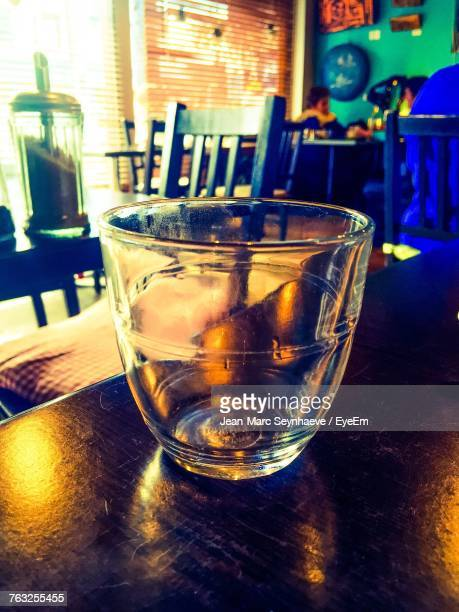Close-Up Of Empty Glass On Table In Restaurant