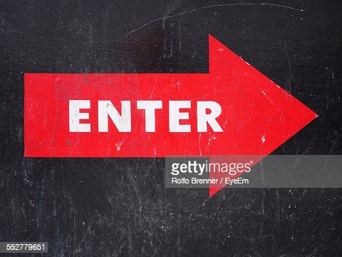 Close-Up Of Enter Sign On Wall