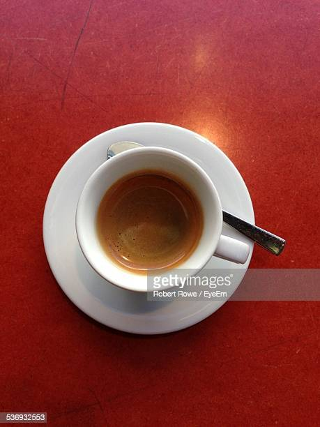 Close-Up Of Espresso Served On Red Table