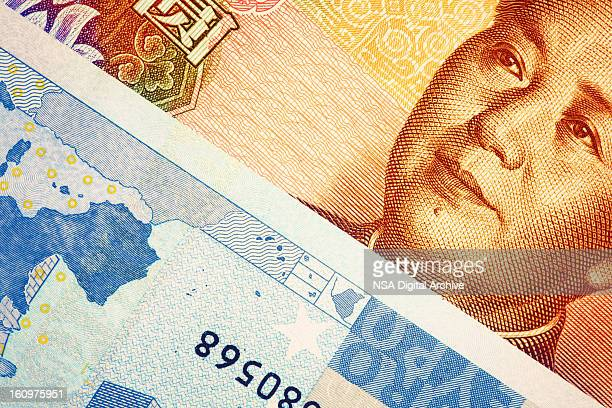Close-up of European Union Euro Note and Chinese Yuan Banknote