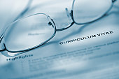 glasses on curriculum vitae