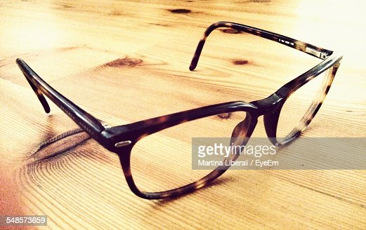 Close-Up Of Eyeglasses On Hardwood Floor