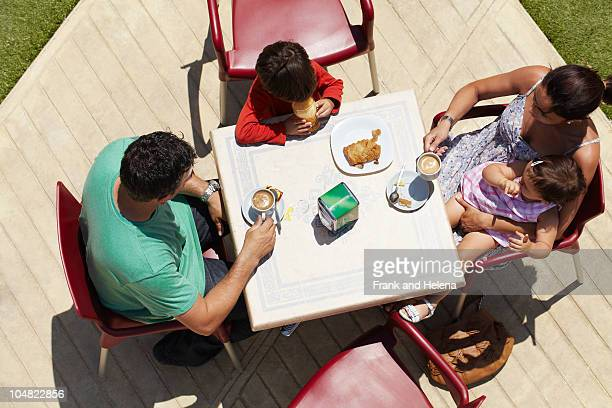 Close-up of family seated around table