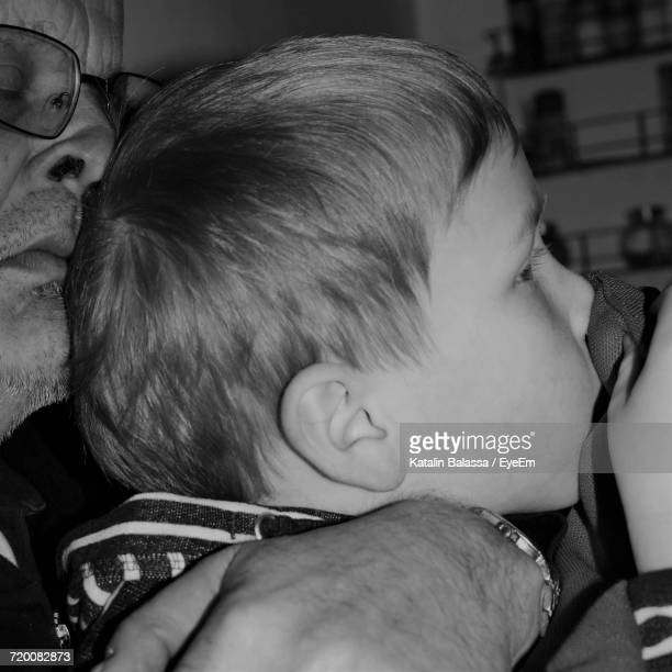 Close-Up Of Father Embracing Son At Home