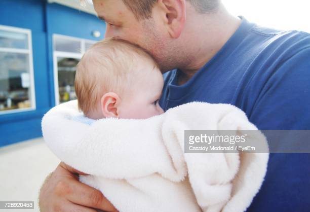 Close-Up Of Father Holding Baby