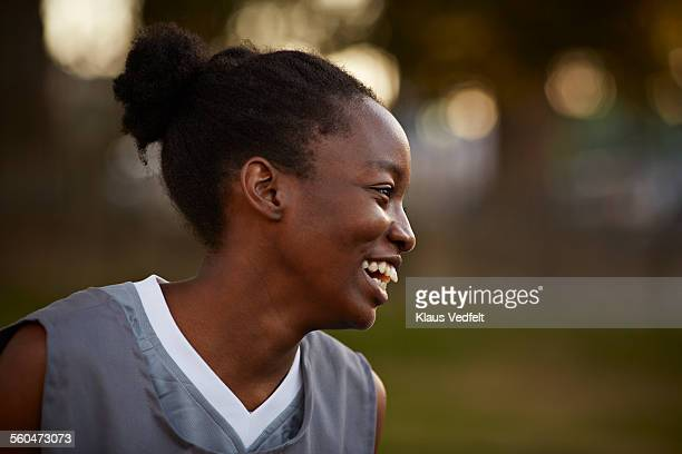 Close-up of female basket player laughing at game