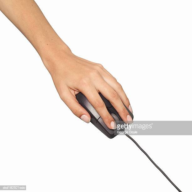Close-up of female hand clicking on computer mouse